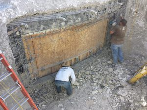 Removal of leaking pool window.